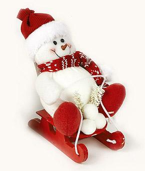 Bonhomme de neige sur sa luge rouge à poser ou suspendre